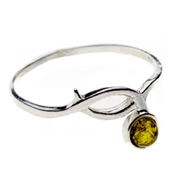 Petite size green oval amber set in sterling silver.