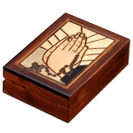 The lid of this beautiful box is decorated with a depiction of praying hands holding a rosary.