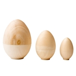 "The egg is such a delightful shape in nature, and this one opens up! This unpainted wooden egg stands just over 4"" tall. Open it up and you find two more eggs inside, one 3"" tall and the smallest just 2"""