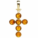"Elegant honey-amber set in 14k gold cross pendant.  Size approx 1.5"" x  .75""."