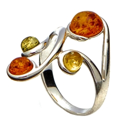 "Large artistic four stone amber ring set in sterling silver. Size approx 1"" x .75""."