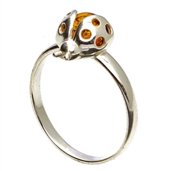 Silver and Amber Ladybug resting on a sterling silver band.