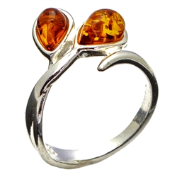 Two teardrop shaped amber pieces set in sterling silver.