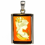 "Beautiful rectangular shaped sterling silver amber cameo pendant. The cameo is hand carved from the back of the pendant. Nicely detailed. Size is approx 1.25"" x .75""."