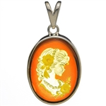 "Beautiful oval shaped sterling silver amber cameo pendant. The cameo is hand carved from the back of the pendant. Nicely detailed. Size is approx 1.5"" x .8""."