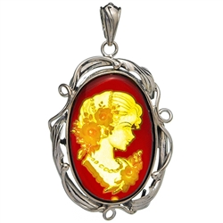 "Beautiful oval shaped sterling silver amber cameo pendant. The cameo is hand carved from the back of the pendant. Nicely detailed. Size is approx 1.75"" x 1.2""."