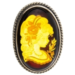 "Beautiful oval shaped sterling silver amber cameo pendant/brooch. Can be worn either as a pendant using the silver loop or as a brooch using the pin. The cameo is hand carved from the back of the pendant. Nicely detailed. Size is approx 1.6"" x 1.2""."