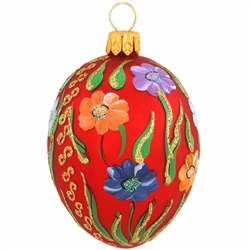 "Masterfully crafted of glass from Poland, this truly egg-straordinary ornament is artfully hand-painted with a myriad of vibrant glazes and glistening glitter accents. Measuring 2½"" tall, our red egg with floral pattern is sure to be an eggs-quisite addit"