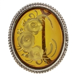 "Beautiful oval shaped sterling silver amber cameo brooch. The cameo is hand carved from the back of the pendant. Nicely detailed. Size is approx 1.25"" x 1""."