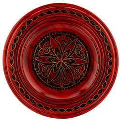 Hand Made in Southern Poland Polish wooden plates are made from Linden wood in the mountain region of southern Poland called Podhale. The plates are cut and shaped on a lathe by hand. The floral designs are burned into the wood before staining and varnish