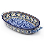 "Pattern designed by master artist Jacek Chyla. The artist has been connected with Handicraft Cooperative ""Artistic Ceramics and Pottery"" since 1986, whereas since 1994 he has been a pattern designer. Unikat pattern number U180. This oval baking dish is ap"