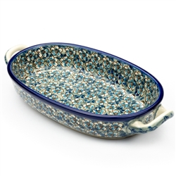 "Pattern designed by master artist Teresa Liana. The artist has been connected with Handicraft Cooperative ""Artistic Ceramics and Pottery"" since 1983, whereas since 1992 she has been a pattern designer. Unikat pattern number U4748. This oval baking dish is"