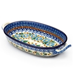 "Pattern designed by master artist Maria Starzyk . The artist has been connected with Handicraft Cooperative ""Artistic Ceramics and Pottery"" since 1995, whereas since 1997 she has been a pattern designer. Unikat pattern number U1588. This oval baking dish"