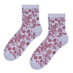 Folk is in fashion and these beautiful Polish hosiery featuring a traditional floral design on a light grey background. Made in Lowicz, Poland.