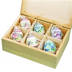 Hand painted duck eggs featuring Polish floral patterns and nested inside a hand painted wooden box. The duck eggs are blown out and come with a ribbon hanger. Eggs are all hand painted and decorations will vary from set to set.