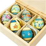 Hand painted duck eggs featuring Polish floral patterns and nested inside a hand painted wooden box. The duck eggs are blown out and come with a ribbon hanger.