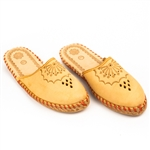 Polish mountain slippers are hand made from leather with open backs, flat sole and heel. Highly decorated and burned with mountaineer symbols these comfortable slippers are perfect for lounging at home in style.  Designs on these slippers varies from ship