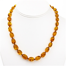 Delicate honey amber beads rounded and knotted between each bead.  Beads are about .5cm in diameter.