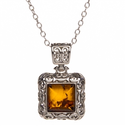 "Sterling Silver with antique detail surrounding a beautiful honey amber cabochon. Necklace size is 16"" long with a 2"" extender. Pendant is 1"" x .75""."