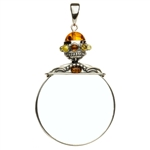 "Unique and beautifully hand-crafted sterling silver magnifying glass decorated with amber highlights. Has its own silver finding which can be used to attach a chain if desired. Size is approx 3.25"" x 2""."