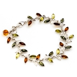 "Three colors of amber set in silver shaped to form a trail of leaves in this lovely bracelet 7.5"" - 19cm long."