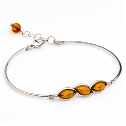 "This sterling silver bracelet features a gorgeous row of honey amber.  Size is 7"" diameter with a 1"" extender."