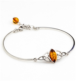 "This sterling silver bracelet features a marquis shaped center of honey amber. Size is 7"" diameter with a 1"" extender."