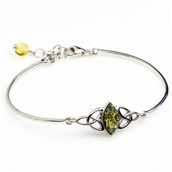 "This sterling silver bracelet features a marquis shaped center of green amber.  Size is 7"" diameter with a 1"" extender."