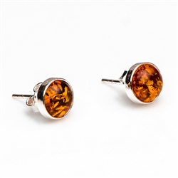 Gorgeous Baltic Amber round stud earrings framed in sterling silver.