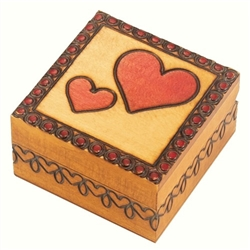 This small square box has one large heart Burned and painted on its lid, with a smaller heart beside it.  A border of hearts runs along the sides of the box. This beautiful box is made of seasoned Linden wood, from the Tatra Mountain region of Pola