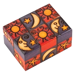 This box is decorated with carved and painted images of the moon, sun and stars on the top and side.  This beautiful box is made of seasoned Linden wood, from the Tatra Mountain region of Poland.