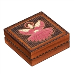 The lid of this beautiful wooden box is decorated with an angel design.