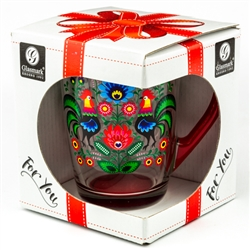 This bright glass mug is decorated with a beautiful Polish paper cut design.  Red handle and base.  Hand wash only.