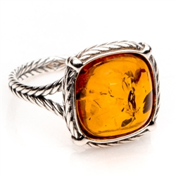 "Honey colored amber and sterling silver rope style ring. Size approx. .6"" square."