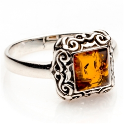 "Honey colored amber and sterling silver filigree ring. Size approx. .4"" square."