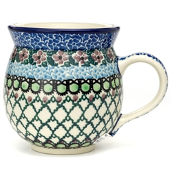"Pattern Designed By Teresa Liana. The artist has been connected with the Artistic Handicraft Cooperative ""Artistic Ceramics and Pottery"" since 1983. Since 1992 she has been a pattern designer. Unikat pattern number U4516"
