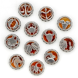 "Sterling silver with Cognac Amber. Size - .75"" diameter."