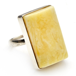 "Beautiful milky custard amber set in sterling silver.  Size is approx. 1.1"" x .75"".  This is the only one available."