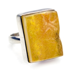 "Natural semi-polished amber in a sterling silver frame.  The surface of the amber has been lightly polished so as to retain its natural textured surface.  Size is approx .8"" x .7"".  Only one ring available."