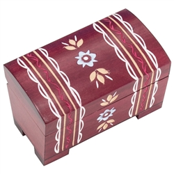 Mountain Chest Wooden Box. This warm colored box is a chest style with a footed base. A handcarved zig-zag and banded pattern wraps over the top from the back to the front.