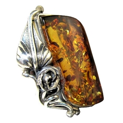"A beautiful slice of honey amber framed in a classic sterling silver frame. Size is approx 1.25"" x .1"". Only one piece this size is available."