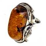 "A beautiful honey amber cabochon framed in a classic sterling silver frame. Size is approx 1.4"" x .1""."