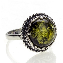 "Green Amber - Sterling Silver 'Regal' Ring. Size approx. .75"" round."