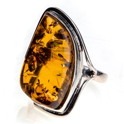 "Honey colored amber and sterling silver ring. Size approx.  1.25"" x .75""."