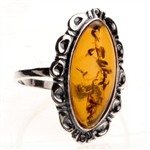 "Honey colored amber framed in sterling silver. Size approx. 1"" x .5""."
