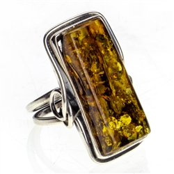 "Beautiful rectangular shaped amber cabochon set in sterling silver. Size approx 1"" x .5"""