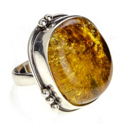 "A large 1"" square amber cabochon set in sterling silver. Size is 7.5"" adjustable one time to 8' - 8.5""."