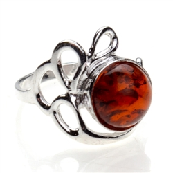 Artistic Round Honey Amber And Silver Ring. A nice size amber cabochon framed in a classic sterling silver frame.