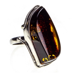 "Dark cognac colored amber and sterling silver ring. Size approx. .75"" x 1.25""."