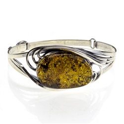 "This sterling silver bracelet features a gorgeous oval amber cabochon. Size is 6.75"" diameter.  Cabochon size is approx 1"" x 1.25""."